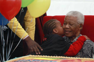 A child kisses Nelson Mandela, Friday, July 31, 2009 during the launch of a children's hospital in Johannesburg, South Africa. (AP/Karel Prinsloo)