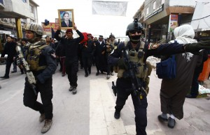 Dozens Killed As Protesters Clash With Iraqi Police
