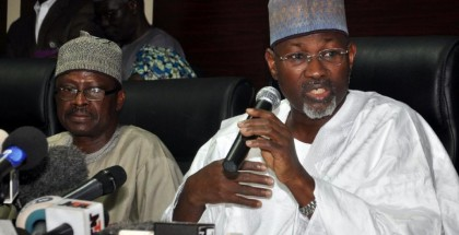 Chairman of the Independent National Electoral Commission Attahiru Jega (R) speaks on February 7, 2015 in Abuja, Nigeria (AFP Photo/)