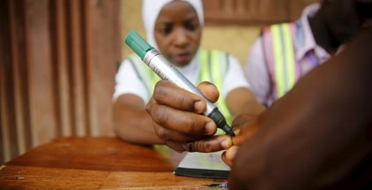 An electoral officer marks the thumb of a voter with ink at the start of voting during the governorship election in Epe district in Nigeria's commercial capital Lagos, April 11, 2015. Reuters/Akintunde Akinleye